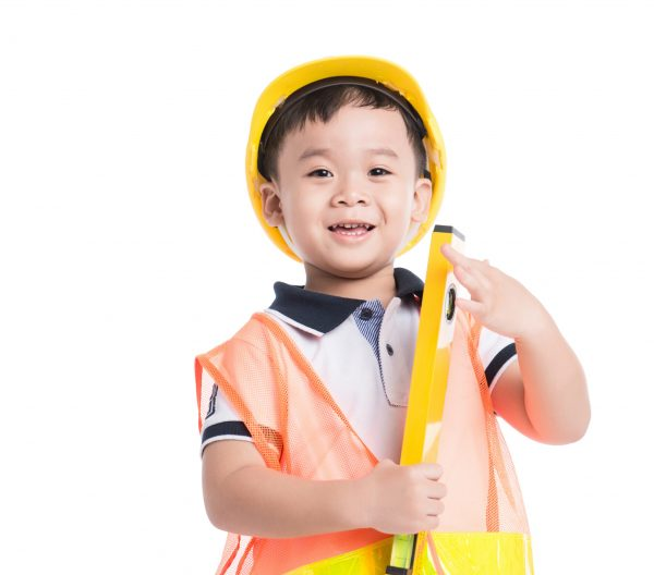 Asian,Boy,Pretending,To,Be,A,Construction,Worker.,Isolated,Over